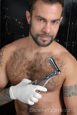 Steve Cruz with anal speculum, playing it safe with latex exam gloves